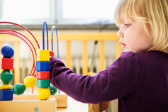 Girl playing with the blocks