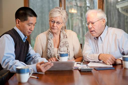 Mature couple working with a financial planner