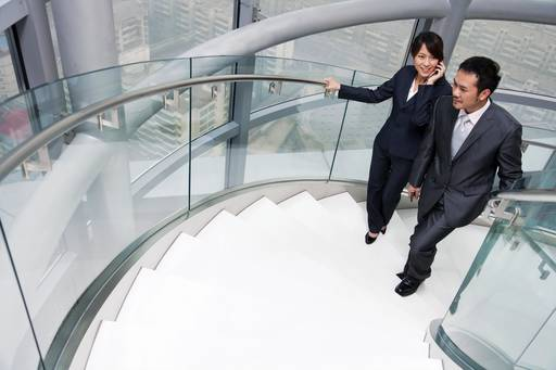 Business people walking up stairs