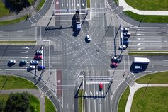 Cars moving through an intersection