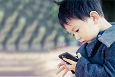 boy playing on a phone