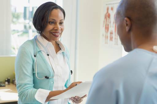 happy-female-doctor-medical-records