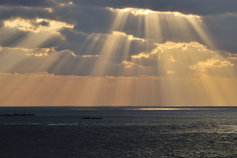 KPMG IFRS Financial Instruments topic image: clouds and shafts of sunlight over water