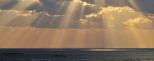 KPMG IFRS Financial Instruments topic image: shafts of sunlight through clouds over the sea