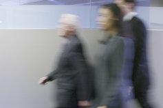 business people walking down a corridor