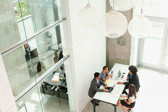 business people working in office together