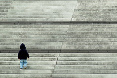 Child walking up stairs