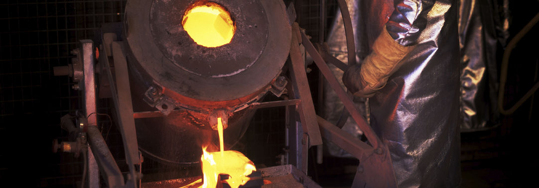 man processing molten metal