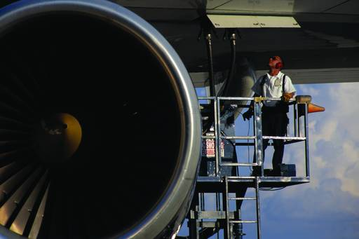 KPMG IFRS In the Headlines 2013/19 (general hedge accounting) publication image: worker working under the wing of an airplane