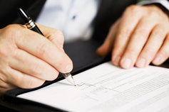 KPMG IFRS international comment letters topic image: person signing a letter.