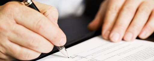KPMG IFRS comment letters image: man signing a document