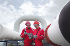 Workers in a gas storage plant