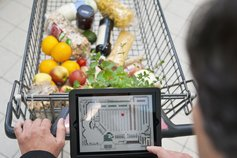 Man using tablet in supermarket,