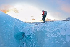 Mountain climber on glacier
