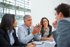 Business people in formal discussion