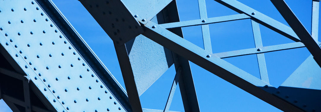 Blue girders against a clear sky