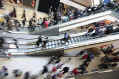 blur of people on a mall escalator
