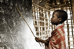 child studying in bamboo classroom