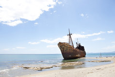 Financial Instruments | Rusting hull of a ship on a beach