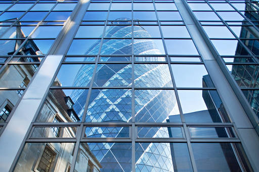 London's 'Gherkin' building reflected in a pane of glass