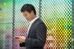 KPMG IFRS 15 (new revenue recognition standard) for sectors topic image: person using a mobile device