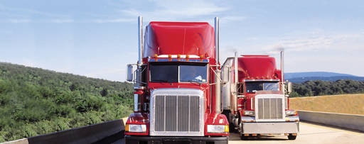 KPMG IFRS Newsletter: Leases publication image: two red trucks on a highway.