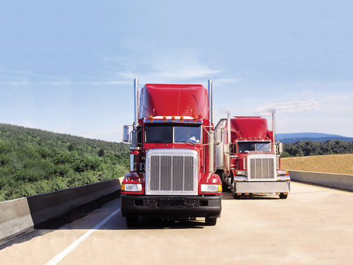 KPMG IFRS Leases topic image: Two red trucks on a highway