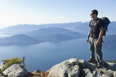 KPMG IFRS Business Combinations topic image: hiker on a mountain with a rucksack.