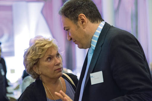 Businessman and woman in a serious discussion