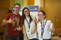Cheerful people wearing glares and KPMG ID cards
