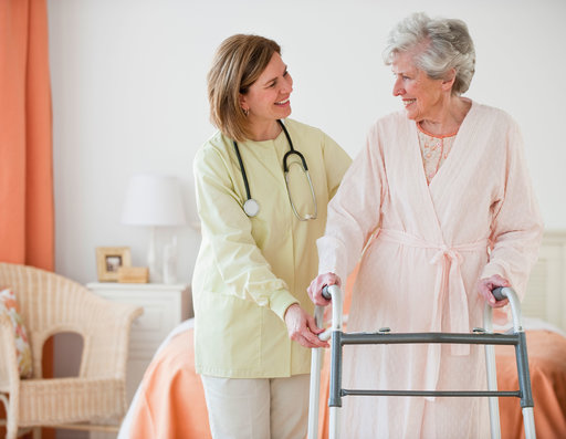 Nurse helps an elderly woman