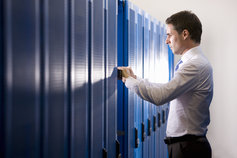 Man searching through stored files