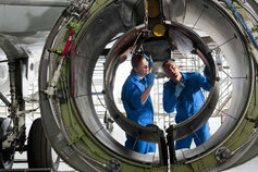 mechanics working on jet engine
