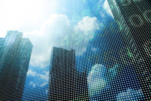Stock market price displayed with modern building background