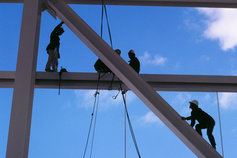 KPMG IFRS Conceptual Framework topic image: Close-up of workers on a building site scaffold.