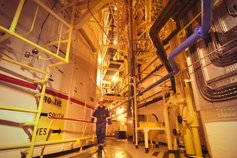 man walking in chemicals plant
