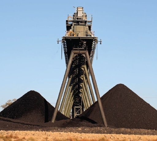 coal heaped under tower