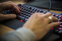 man using keyboard
