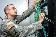 An officer working with wires