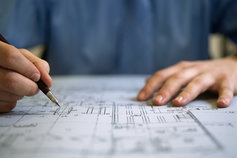 Architect drawing a plan
