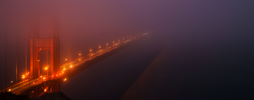golden gate bridge in fog at night