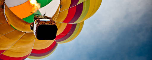 Colourful parachute flying in the sky