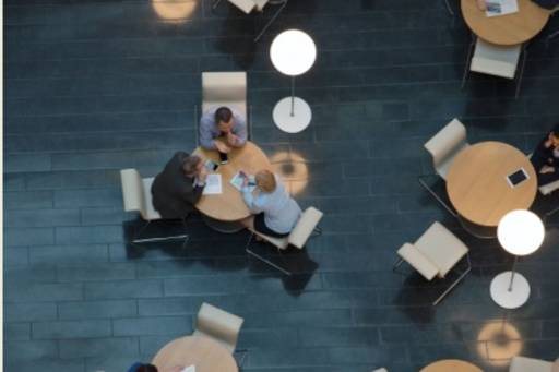 People sitting on conference tables