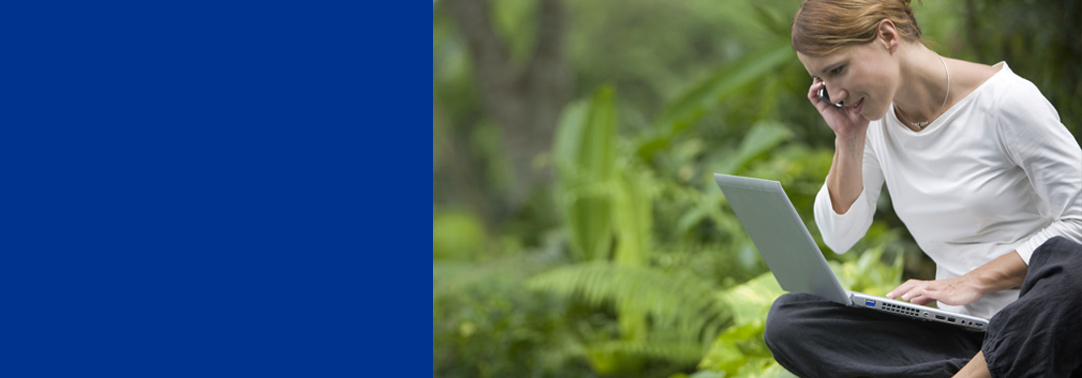 KPMG Global IFRS Institute image: woman in a forest using a laptop and a smartphone.