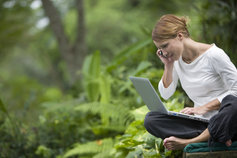 Woman working in natural environment