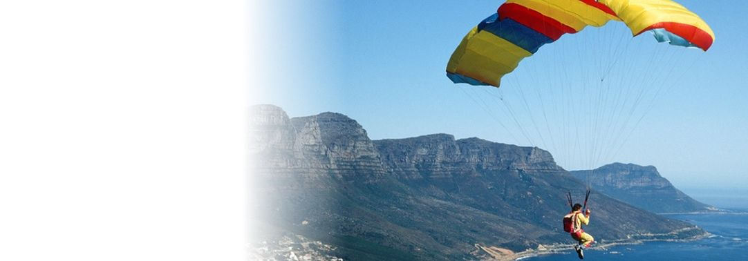 KPMG IFRIC draft proposals on accounting for uncertaity in income tax treatments publication image: Paraglider descending toward the coast.