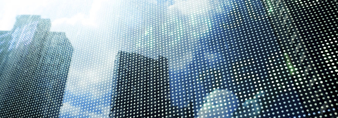KPMG IFRS Newsletter: Banking (The Bank Statement) publication cover image: Office blocks reflected on a digital stock market price display.