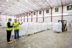 Workers in recycling warehouse