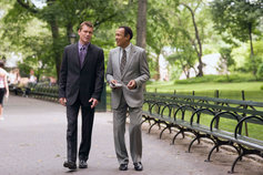 Businessmen talking in park