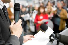 man-holding-a-microphone
